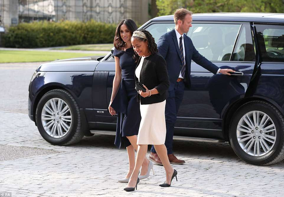 Meghan and her mother, both wearing high heels, arrive at the hotel on the National Trust's Cliveden Estate