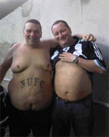 Mike Ashley - with the new St. James' Park academy product