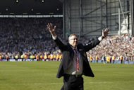Manchester United's Scottish manager Alex Ferguson acknowledges fans at The Hawthorns in West Bromwich, on May 19, 2013