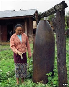 A defused US bomb being used as a bell at a school in Laos