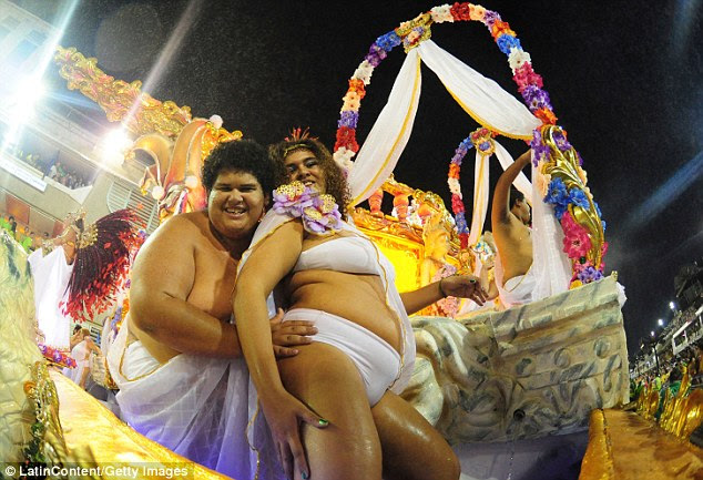Big pride: Members of Mocidade Independente de Padre Miguel dance during the Rio carnival