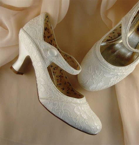 Pretty ivory lace wedding shoes, decorated with soft