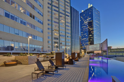 Olympus Property is proud to announce the acquisitions of Mosaic in downtown Dallas. This image displays the pool deck area with stunning views of downtown Dallas.