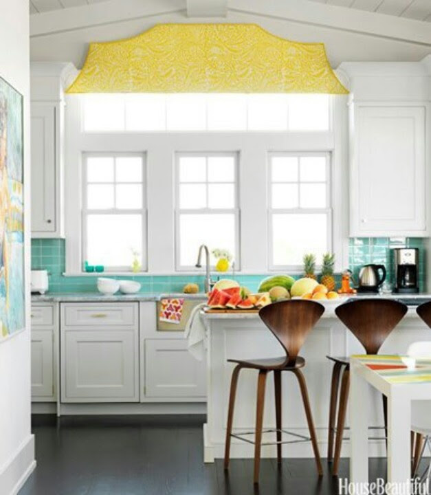 This clean white kitchen brightens up with turquoise and yellow accents.