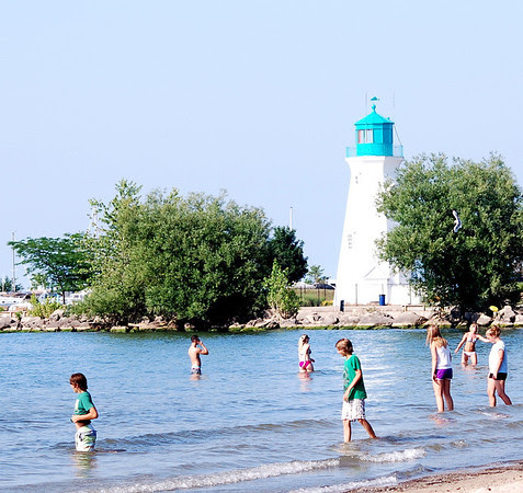 Beach-goers enjoy Lake Ontario at Port Dalhousie's Lakeside Park.