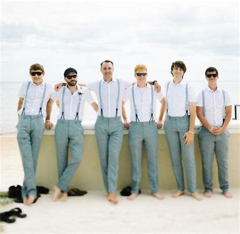 Groomsmen at a beach wedding with grey slacks and light