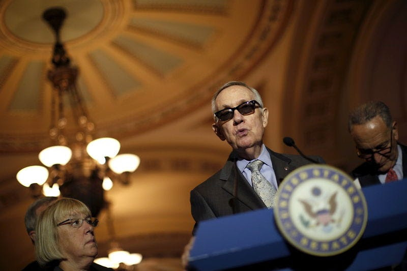 U.S. Senate Minority Leader Harry Reid (D-NV) talks to reporters during a new conference following party policy lunch meeting at the U.S. Capitol in Washington August 4, 2015. REUTERS/Carlos Barria