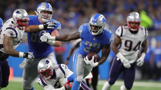 Detroit Lions quarterback Matthew Stafford is protected by his offensive line, including guard T.J. Lang, left, and guard Frank Ragnow, right, as he passes against the New England Patriots during the first quarter Sunday, Sept. 23, 2018 at Ford Field in Detroit. Kirthmon F. Dozier, Detroit Free Press
