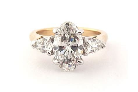 Oval diamond ring with pear shape side stones   Browse