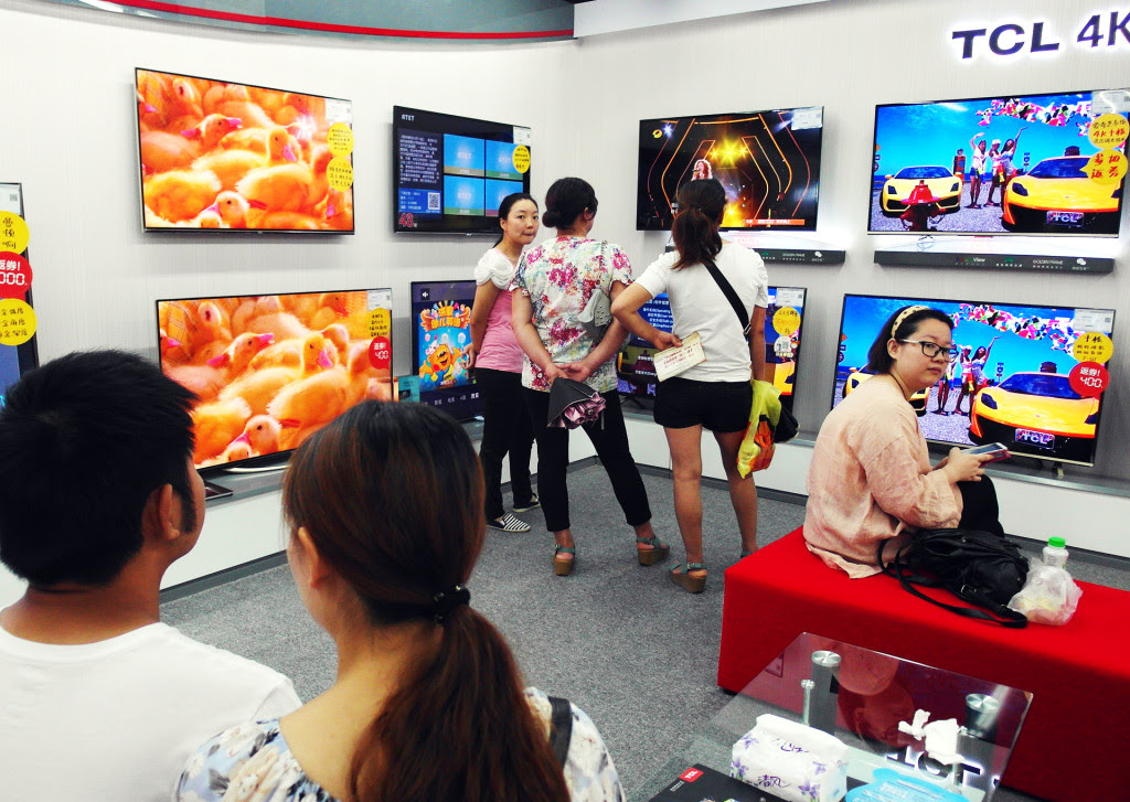 Customers shop for televisions at a store in Yichang, Hubei province, China, on July 11, 2015.