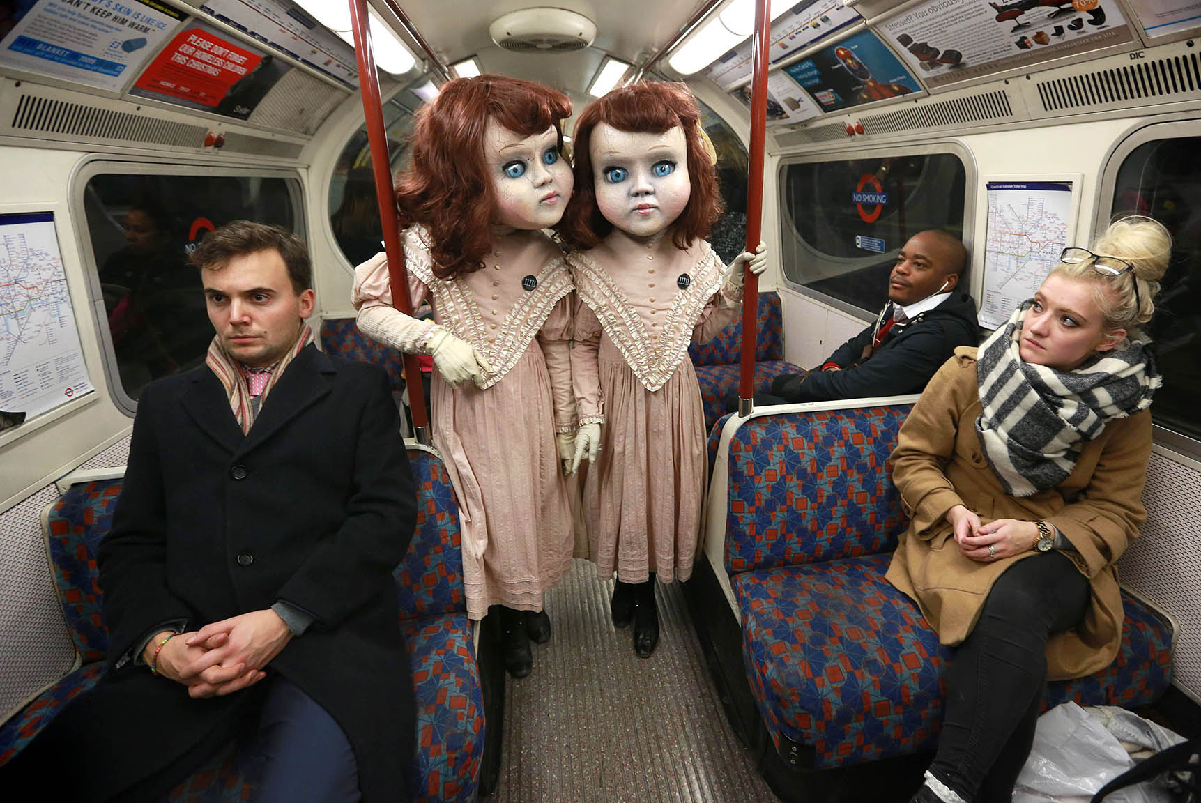 Two life-size Victorian style dolls