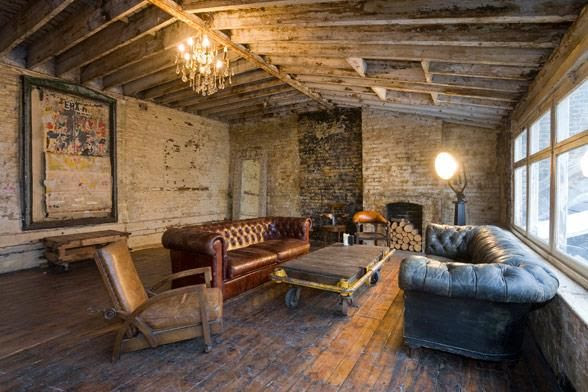 #raw #brick work walls, wooden #beamed ceiling and #leather #chesterfield #sofas from wwwshootfactory.co.uk