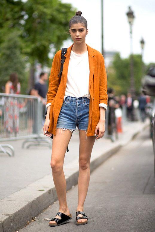 Le Fashion Blog Model Off Duty Style Top Knot Orange Blazer White Tee Cut Off Denim Shorts Black Birkenstock Sandals Via Harpers Bazaar