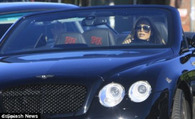 All mine: One of Kim's first purchases was this $190,000 black Bentley Continential GT with monogrammed seats