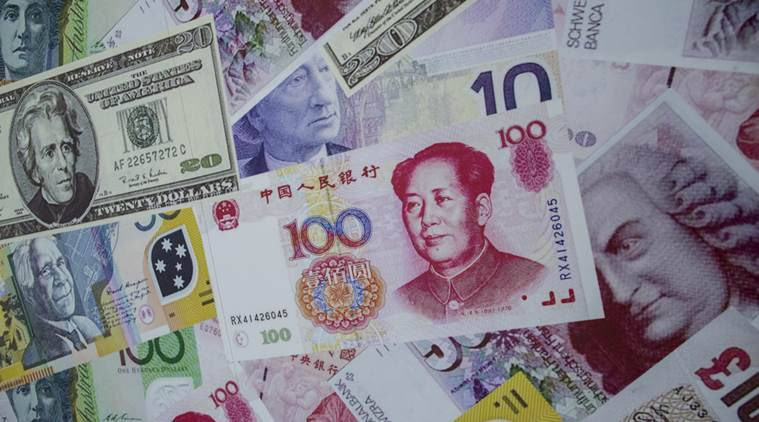 China's yuan edges up on stronger fixing