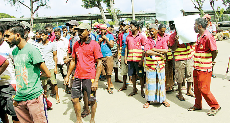 Sanitary workers of the Kurunegala MC demonstrating on behalf of their colleague. Picture by Kurunegala Additional Corr.