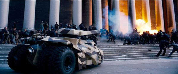 A camouflaged Tumbler, commandeered by Bane's men, wreaks havoc in THE DARK KNIGHT RISES.