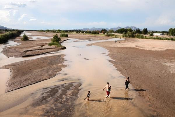 "In New Mexico, water levels in the once-mighty Rio Grande are so low that it is often referred to as the ""Rio Sand."" In some parts of the state, officials fear ecosystems are collapsing. (Credit:  Los Angeles Times)"