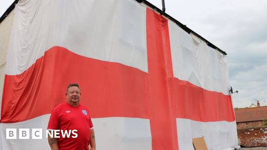'Mad fan' shows support with giant flag