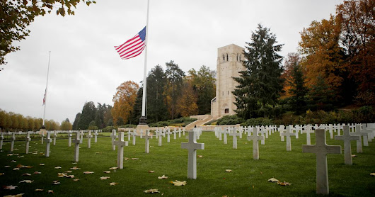 White House decision to cancel veterans' cemetery visit in France creates a storm of its own