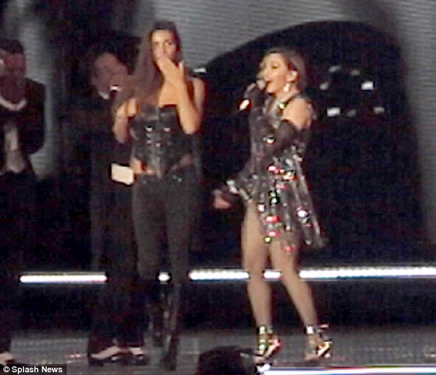 Shocked: The fan appeared shock as her bustier was pulled down by the Crazy For You singer but said she also had a wardrobe malfunction