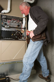 hvac contractor inspecting furnace