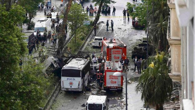 Fire engines stand beside a Turkish police bus which was targeted in Istanbul