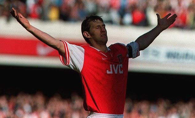 Leader and legend: Tony Adams' famous celebration against Everton was captured
