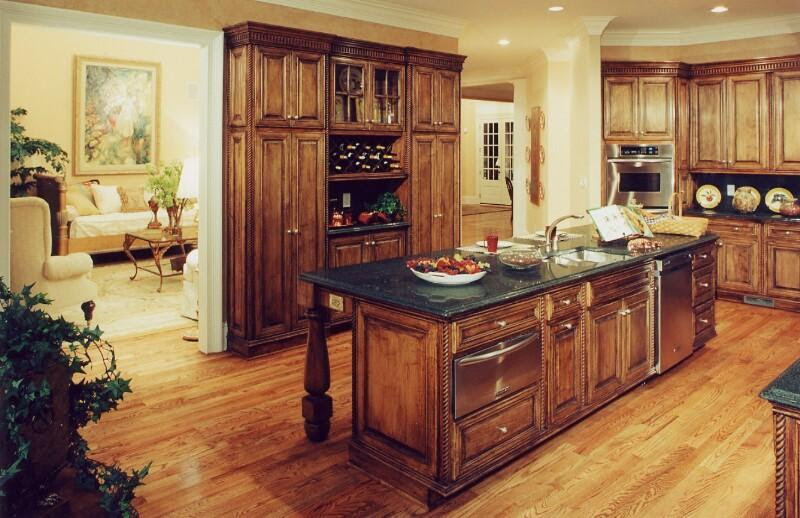 Rustic style kitchen cabinets and sink over the granite ...