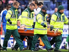 James McCarthy is carried off in the draw with Bolton