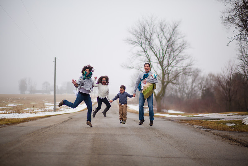 A natural and candid photo session with the Velasquez family and their newborn baby boy for an in home session in Belvidere IL. There are a mix of mom and dad and brother and sister portraits with their precious new son that capture the love and excitement for their new family member!