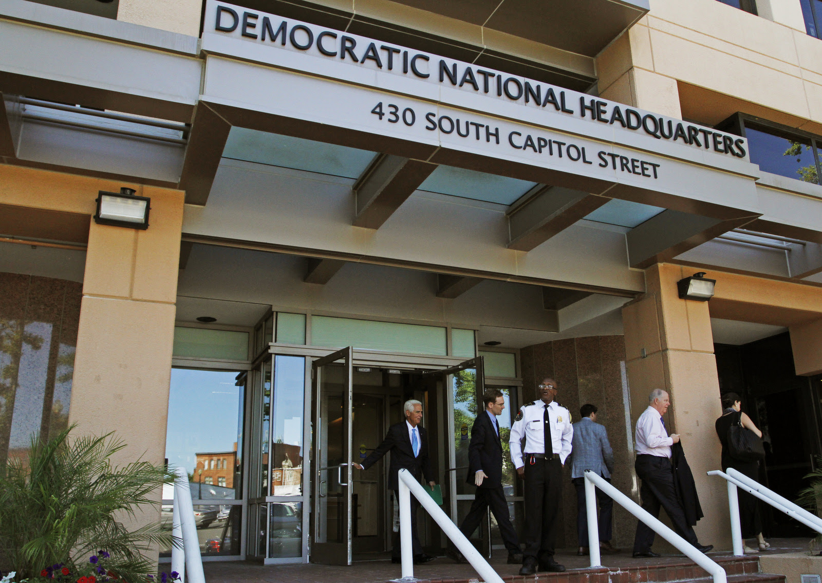 People stand outside the Democratic National Committee (DNC) headquarters in Washington (AP/Paul Holston)