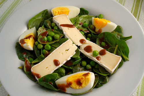 Eggs on Baby Spinach with Peas and Brie