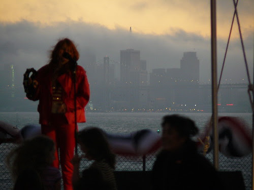 Lights alight across the bay as the band completes its set