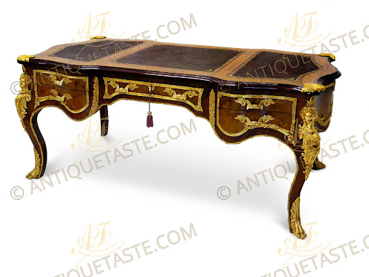 A sensational and grand French 19th century Louis XV style ormolu mounted veneer inlaid five drawers Executive Bureau Plat after a model by Francois Linke