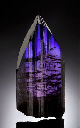 "Tanzanite :: Since tanzanite is a gem stone, it's rare to find a crystal like this one. Ka-ching! Measures: 4 1/8"" x 1 7/8"" x 3/4"" Estimate: $ 300,000-$ 350,000"