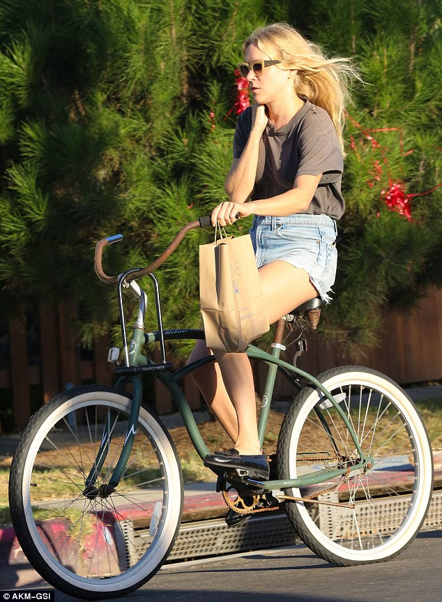 Cycle dash: the actress opted for laid back LA-chic in a tiny pair of hotpants, flat and some seriously cool retro-style sunglasses as she picked up her lunch in LA