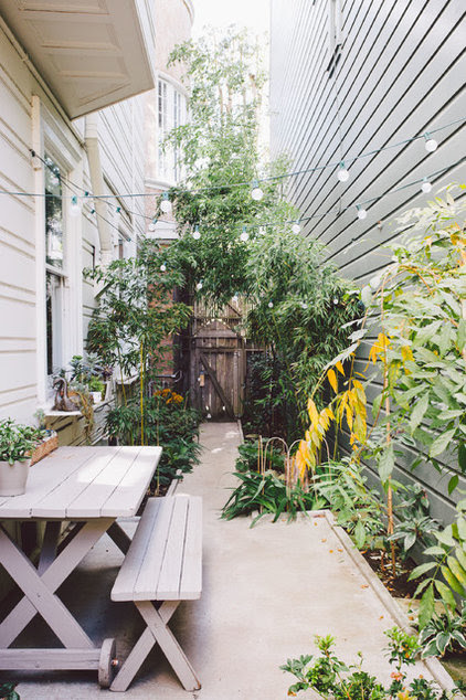 Traditional Patio by Nanette Wong