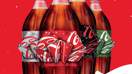 Coca-Cola's Ingenious Holiday Bottle Has a Label You Pull Into a Festive Bow