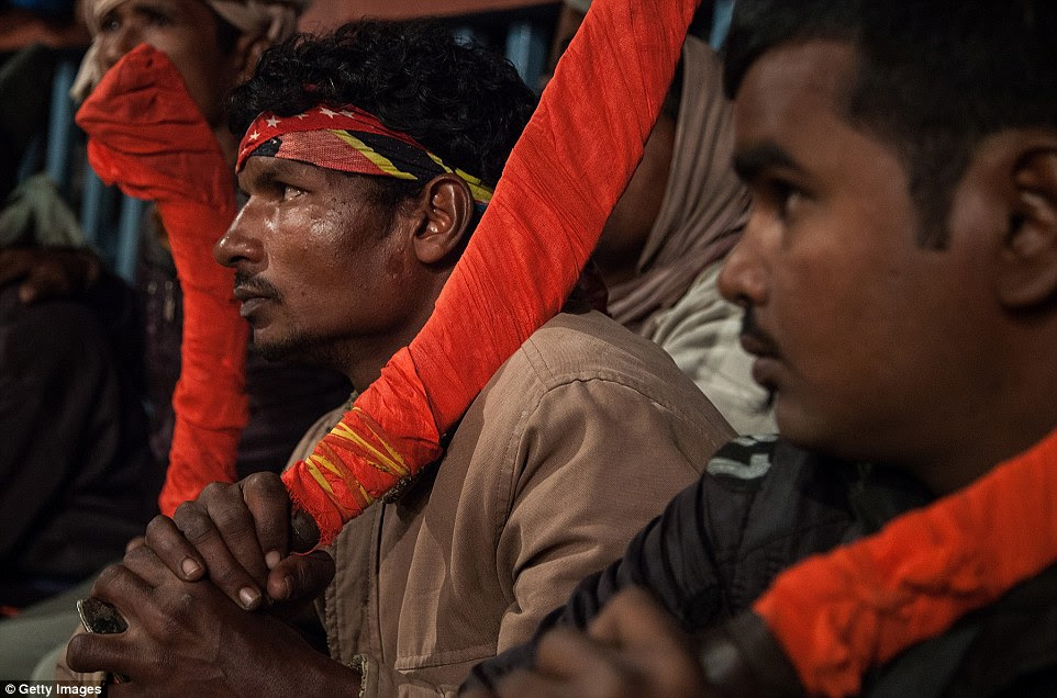 A group of devotees hold their traditional kukri knifes before the beginning of the animal sacrifices