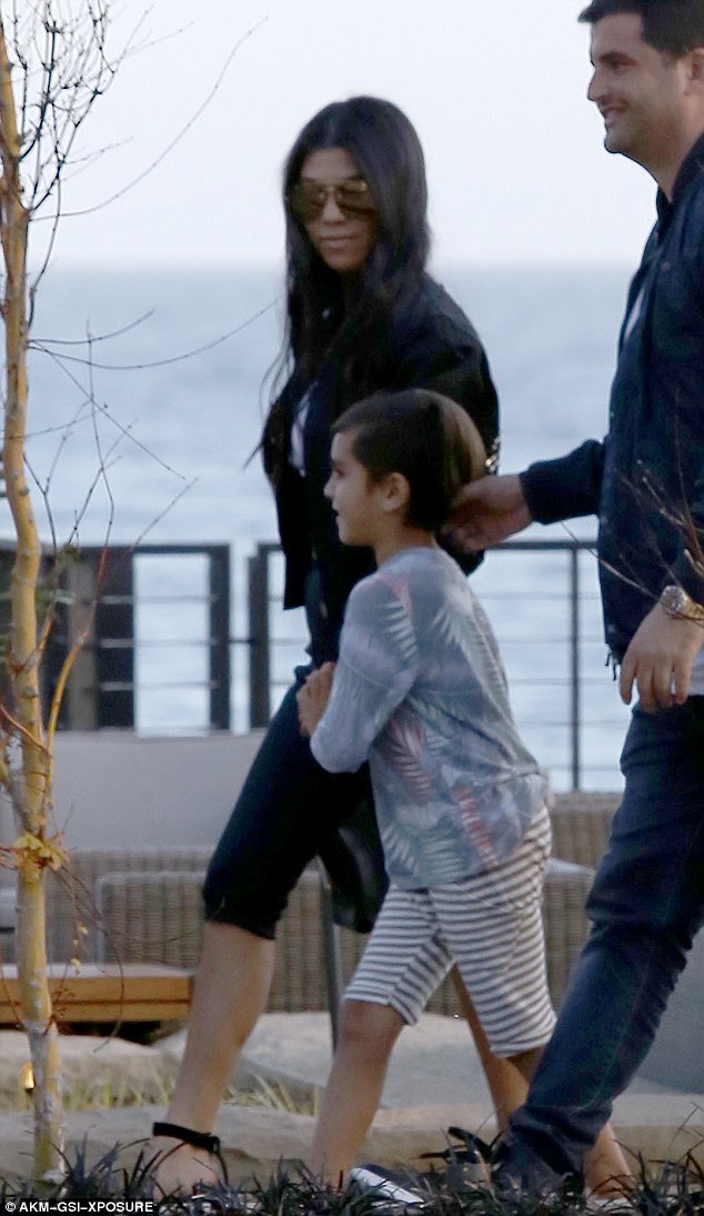 Mom and son: Kourtney accompanied her son with Scott - Mason, who's six. The youngster wore a pair of striped shorts and a pastel-colored long-sleeved shiort