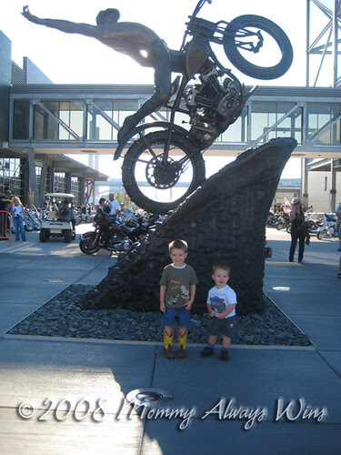 Boys in front of the statue at the Harley Museum
