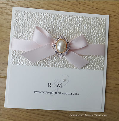 Pebble, sequin embossed paper with a gold pearl embellishment - Crystal Pebble Wedding Invitations and Stationery
