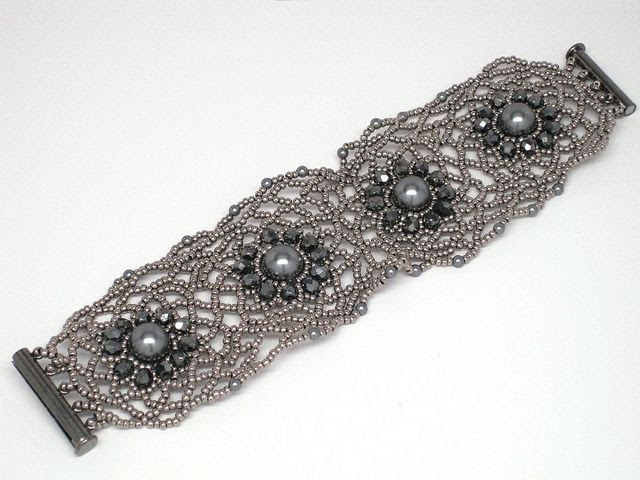 Freeform netting bracelet - silver and gunmetal  Made from Swarovski pearls, fire-polished crystals and seed beads. Design by Magdalena Connelly.