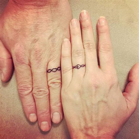25  best ideas about Couples Ring Tattoos on Pinterest