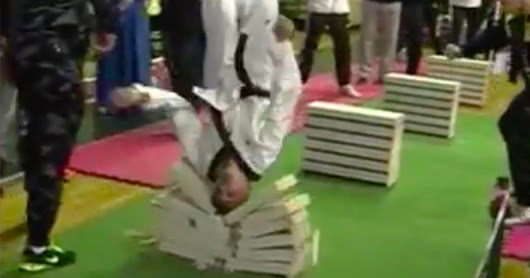 Record-breaking martial arts pro, 16, smashes through 111 building blocks using just his HEAD