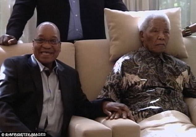 Zuma was arrested aged 21 for conspiring to overthrow the government and served ten years on Robben Island — alongside Mandela (right) — in the infamous jail.