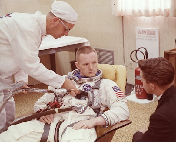 """FILE - In this March 9, 1966 file photo, Astronaut Neil Armstrong is seated during a suiting up exercise Cape Kennedy, Florida, in preparation for the Gemini 8 flight. The family of Neil Armstrong, the first man to walk on the moon, says he has died at age 82. A statement from the family says he died following complications resulting from cardiovascular procedures. It doesn't say where he died. Armstrong commanded the Apollo 11 spacecraft that landed on the moon July 20, 1969. He radioed back to Earth the historic news of """"one giant leap for mankind."""" Armstrong and fellow astronaut Edwin """"Buzz"""" Aldrin spent nearly three hours walking on the moon, collecting samples, conducting experiments and taking photographs. In all, 12 Americans walked on the moon from 1969 to 1972. (AP Photo/FILE)"""