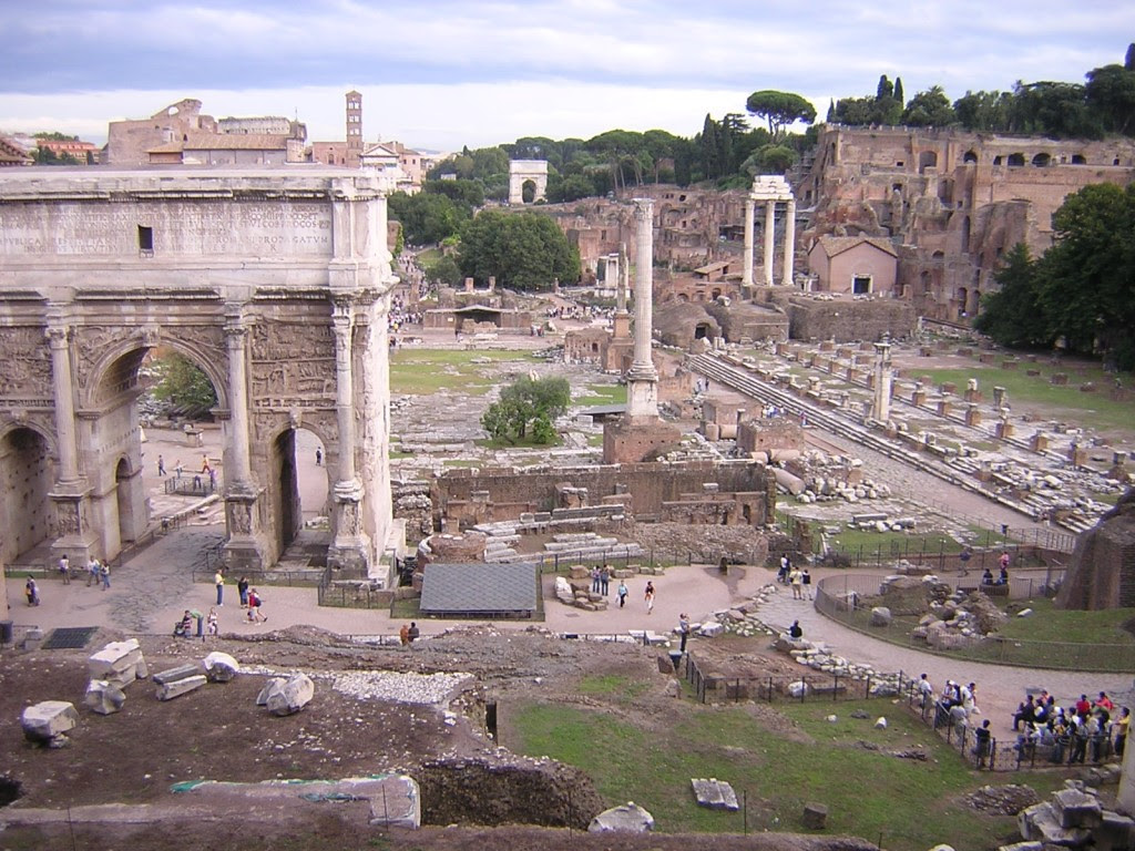 I am now standing on the Capitoline Hill, with the Temple of Jupiter behind me.  I am looking down the forum, and the Palatine hill, where the Imperial Palace was, is the high tree-lined crest to the right.