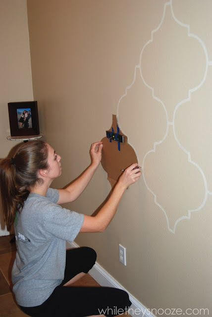 I would love to do this on an empty wall in my home! DIY Moroccan-Style Wall Stencil Tutorial - tape a level to your stencil to get a perfectly straight pattern.
